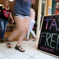Shoppers move in and out of Reed's department store during the no tax sales event Friday afternoon at The Mall at Barnes Crossing in Tupelo.
