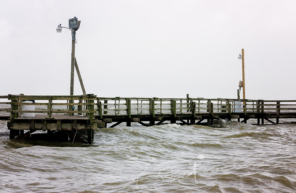 Waves from Tropical Storm Cindy lap beneath Cedar Point Pier, June 22, 2017, in Coden, Ala. The area experienced significant flooding and high surf following heavy rains caused by Tropical Storm Cindy. The tropical storm made landfall at daybreak near Lake Charles, La., leaving one person dead and a drenched Gulf Coast, from Texas to Florida, in its wake. (Photo by Carmen K. Sisson/Cloudybright)