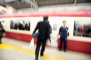 business commuters entering a train Japan Tokyo