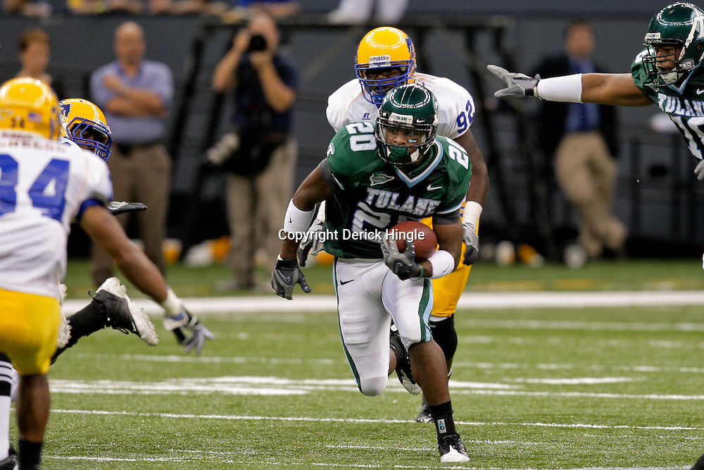 Sep 26, 2009; New Orleans, LA, USA;  Tulane Green Wave wide receiver Jeremy Williams (20) runs with the ball against the McNesse State Cowboys at the Louisiana Superdome. Tulane defeated McNeese State 42-32. Mandatory Credit: Derick E. Hingle-US PRESSWIRE