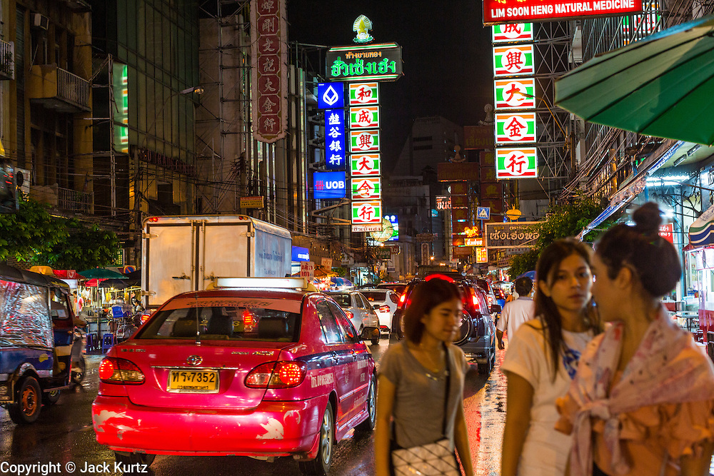 18 SEPTEMBER 2013 - BANGKOK, THAILAND: Evening traffic on Yaowarat Road in the Chinatown section of Bangkok. Thailand in general, and Bangkok in particular, has a vibrant tradition of street food and eating on the run. In recent years, Bangkok's street food has become something of an international landmark and is being written about in glossy travel magazines and in the pages of the New York Times.      PHOTO BY JACK KURTZ