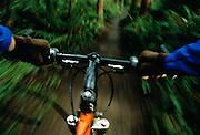 Image of mountain bike handlebars in motion, model released ..