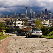 Seattle skyline under stormy sky from W. Kinnear Place on the south slope of Queen Anne Hill, Seattle, Washington