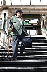 Man walking down steps at railway station,