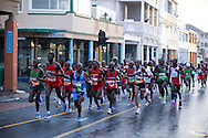 Runners make their way through the rain during the Old Mutual Two Oceans Ultra Marathon on Saturday 7 April 2012 in Cape Town, South Africa..Photo by ImageSA/Old Mutual