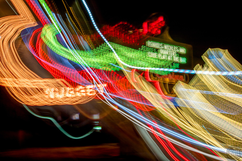 """Tahoe Lights 4"" - Photograph taken at the Lake Tahoe northern state line casinos. The look was achieved by shooting a handheld long exposure and zooming the lens during the exposure."