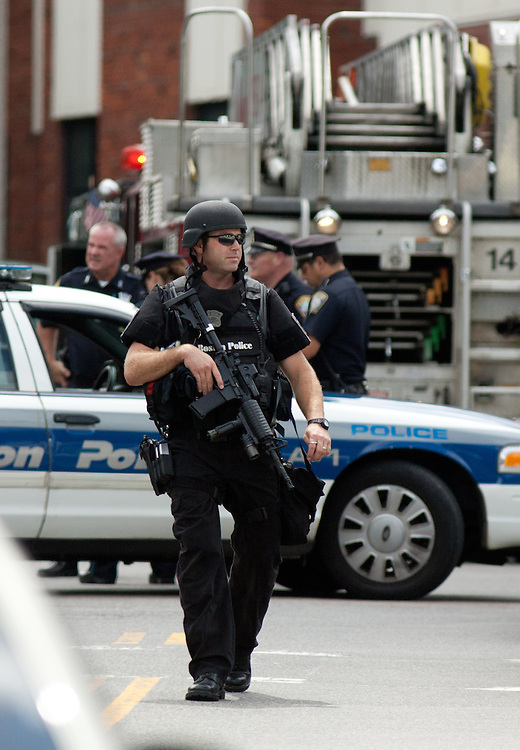 Boston, MA 08/10/2011.A Boston Police SWAT officer leaves the scene of a fatal shooting at 17 Ledgemere Rd. in Brighton on Wednesday morning.  .Alex Jones / www.alexjonesphoto.com
