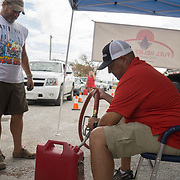 MARATHON, FL - SEPTEMBER 16: <br /> Motorists receive free gasoline from the Fuel Relief Fund group in Big Pine Key  on September 16, 2017 in Marathon, Florida.  (Photo by Angel Valentin/Getty Images)