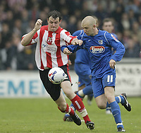 Photo: Aidan Ellis.<br /> Lincoln City v Grimsby Town. Coca Cola League 2, Play off Semi Final. 13/05/2006.<br /> Grimsby's Andy Parkinson and Lincoln's Lee Beevers battle fpor Possesion