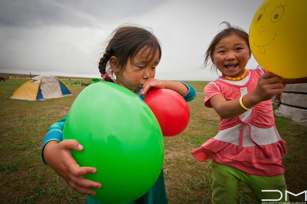 Children playing with ballons.
