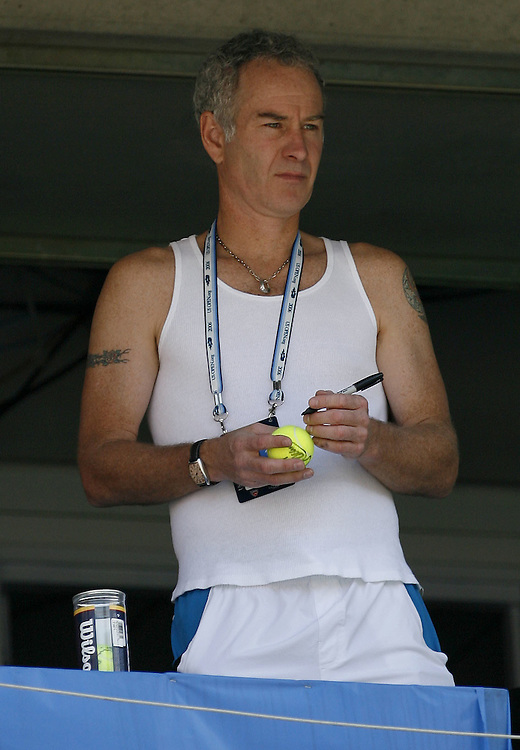 US tennis great John McEnroe watches the doubles match between Lisa Raymond/Samantha Stosur and Martina Navratilova/Nadia Petrova  on the eleventh day of the 2006 US Open tennis tournament in Flushing Meadows, New York Thursday 07 September 2006.