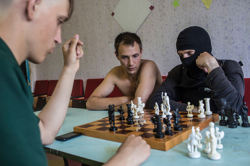 DNIPROPETROVSK REGION, UKRAINE - MAY 19: Members of the Donbass Battalion, a pro-Ukrainian militia, play chess in their barracks on May 19, 2014 in Dnipropetrovsk Region, Ukraine. A week before presidential elections are scheduled, questions remain whether the eastern regions of Donetsk and Luhansk are stable enough to administer the vote. (Photo by Brendan Hoffman/Getty Images) *** Local Caption ***