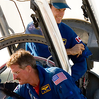 Canadian Space Agency astronaut Steven MacLean, top, adjusts his flight suit after arriving with NASA astronaut Joseph Tanner for dress rehearsal for STS-115 aboard the Space Shuttle Atlantis in Cape Canaveral, Fla. on August 7, 2006. REUTERS/Scott Audette (UNITED STATES)