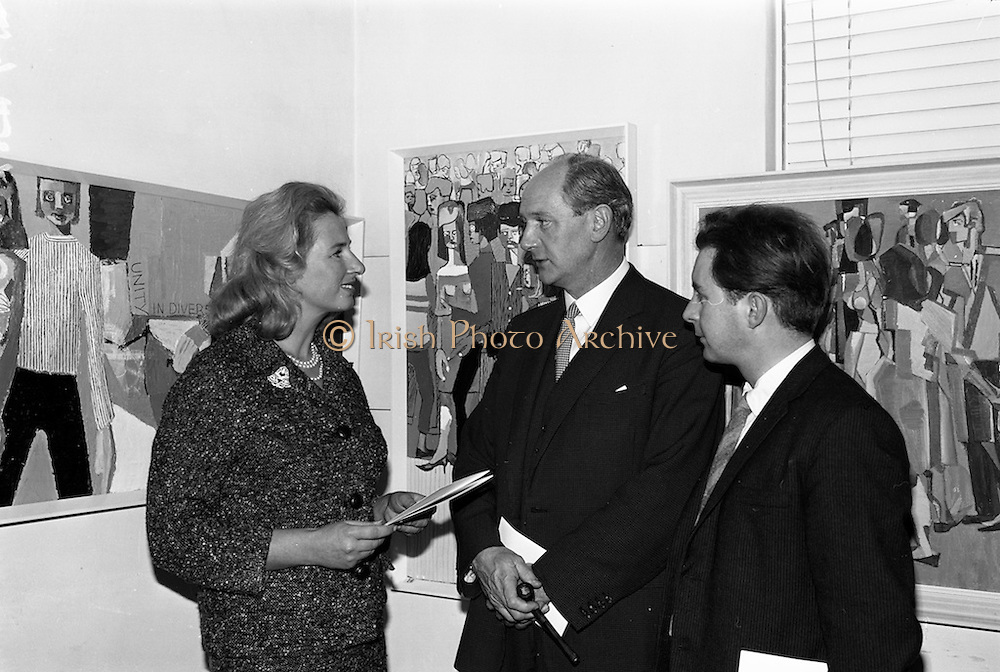 18/11/1964<br /> 11/23/1964<br /> 18 November 1964<br /> <br /> Mr. Jack Lynch Minister for industry and Commerce who wpend and exhibition of paintings by the Cork Artist, Mortimer O'Shea (right) chatting with the Artist and Mrs Ann Proud Director of the Gallery at Molesworth gallery Dublin.