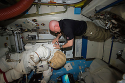 EARTH Aboard the International Space Station -- 27Jan 2016 -- NASA astronaut Scott Kelly relocates spacewalk hardware and suits inside the Quest airlock of the International Space Station. EXPA Pictures © 2016, PhotoCredit: EXPA/ Photoshot/ Atlas Photo Archive/NASA<br />