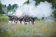 The Battle of Crysler's Farm  U.S. forces erupts in fire and smoke as it fires a massed volley at British line.  U.S. detachment fires back at British line during Saturday evening battle inside Upper Canada Village.   The Battle of Crysler's Farm.