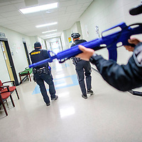 McKinley County Sheriff's Deputies sweep through the hallways of Wingate High School during an Active Shooter training exercise at Wingate High School Friday.