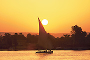 Egypt, Luxor 1999 - A Felucha glides through the sunset on the Nile River