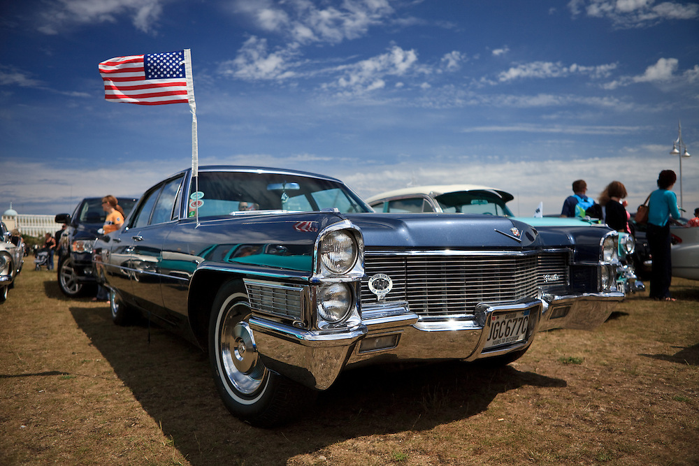 '65 Cadillac Eldorado proudly waves her American flag in the English sea breeze.