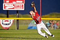 Hayden shortstop Jake Kettell makes a diving catch after back pedaling into left field to grab a pop fly during the State Little League tournament Friday against Northwest Ada at Croffoot Park in Hayden.