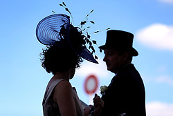 Racegoers silhouetted during day four of Royal Ascot at Ascot Racecourse.