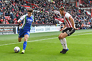 Wigan Athletic midfielder Josh Windass (10)  and Sheffield United defender Jack O'Connell (5)  during the EFL Sky Bet Championship match between Sheffield United and Wigan Athletic at Bramall Lane, Sheffield, England on 27 October 2018.