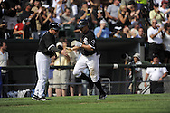 CHICAGO - JUNE 27:  Scott Podsednik #22 is greeted by third base coach Jeff Cox #8 of the Chicago White Sox after hitting a home run in the fifth inning against the Chicago Cubs on June 27, 2009 at U.S. Cellular Field in Chicago, Illinois.  The White Sox defeated the Cubs 8-7.   (Photo by Ron Vesely)