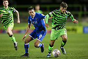 Forest Green Rovers Josh March(28) runs past Carlisle United's Mike Jones(8) during the EFL Sky Bet League 2 match between Forest Green Rovers and Carlisle United at the New Lawn, Forest Green, United Kingdom on 28 January 2020.