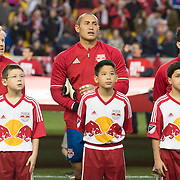 Mar 19, 2016; Harrison, NJ, USA;  New York Red Bullbplayers stand with young fans before a game against Houston DynamoRed at Bull Arena. Red Bulls defeat the Dynamo 4-3. Mandatory Credit: William Hauser-USA TODAY Sports