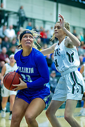 BLOOMINGTON, IL - January 04: Bernie Coderre defended by Catie Eck during a college women's basketball game between the IWU Titans  and the Millikin Big Blue on January 04 2020 at Shirk Center in Bloomington, IL. (Photo by Alan Look)