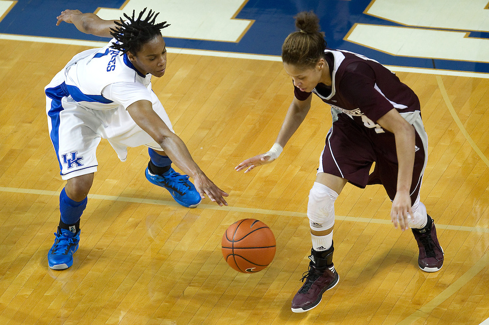 UK guard A'dia Mathies, left, reaches for a ball being dribbled by Mississippi State guard Kendra Grant in the first half. The University of Kentucky Women hosted Mississippi State University Thursday, Jan. 17, 2013 at Memorial Coliseum in Lexington. Photo by Jonathan Palmer
