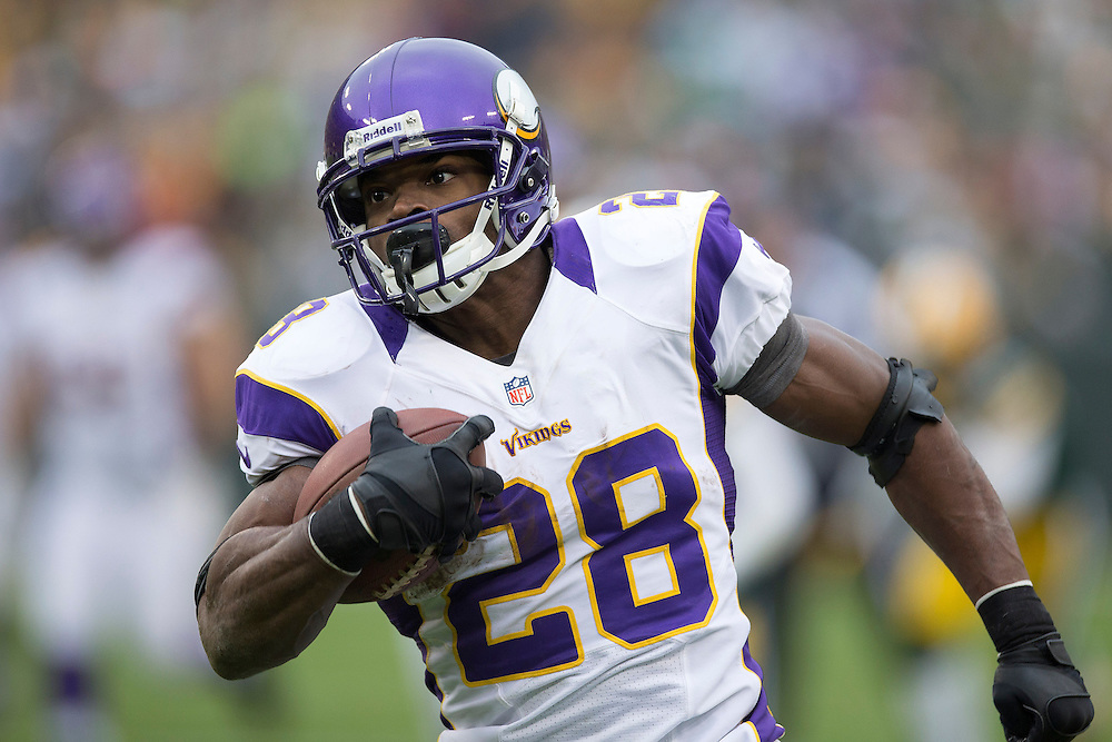 GREEN BAY, WI - DECEMBER 2:  Adrian Peterson #28 of the Minnesota Vikings runs the ball against the Green Bay Packers at Lambeau Field on December 2, 2012 in Green Bay, Wisconsin.  The Packers defeated the Vikings 23-14.  (Photo by Wesley Hitt/Getty Images) *** Local Caption *** Adrian Peterson