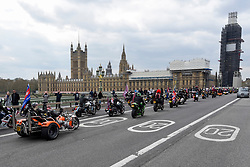 "© Licensed to London News Pictures. 12/04/2019. LONDON, UK.  Thousands of bikers cross Westminster Bridge in a rally called ""Rolling Thunder"" in central London in support of ""Soldier F, a 77-year-old Army veteran who faces charges of murder after killing two civil rights demonstrators in Londonderry, Northern Ireland, in 1972, on what became known as Bloody Sunday.  Photo credit: Stephen Chung/LNP"