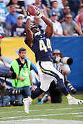 Los Angeles Chargers running back Andre Williams (44) leaps and catches a punt during the 2017 NFL week 1 preseason football game against the Seattle Seahawks, Sunday, Aug. 13, 2017 in Carson, Calif. The Seahawks won the game 48-17. (©Paul Anthony Spinelli)