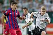 (R) Legia's Dominik Furman fights for the ball during the UEFA Champions League play-off second leg match between Legia Warsaw and FC Steaua Bucuresti at Pepsi Arena Stadium in Warsaw on August 27, 2013.<br /> <br /> Poland, Warsaw, August 27, 2013<br /> <br /> Picture also available in RAW (NEF) or TIFF format on special request.<br /> <br /> For editorial use only. Any commercial or promotional use requires permission.<br /> <br /> Photo by © Adam Nurkiewicz / Mediasport