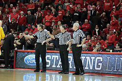 22 January 2014:  Referees Randy Heimerman, Mike Stuart, Thomas Eades during an NCAA Missouri Valley Conference mens basketball game between the Shockers of Wichita Stat and the Illinois State Redbirds  in Redbird Arena, Normal IL.