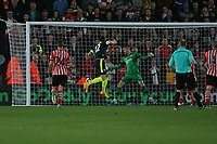 Football - 2016 / 2017 Premier League - Southampton vs. Arsenal<br /> <br /> Olivier Giroud of Arsenal heads in Arsenals second goal at St Mary's Stadium Southampton<br /> <br /> COLORSPORT/SHAUN BOGGUST