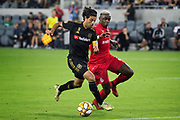 LAFC forward Carlos Vela (10) dribbles the ball while being defended by Toronto FC defender Chris Mavinga (23)  during a MLS soccer game between the LAFC and the Toronto FC. LAFC and Toronto FC tied 1-1 on Saturday, Sept 21, 2019, in Los Angeles. (Ed Ruvalcaba/Image of Sport)
