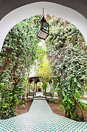 Patio garden with fountain in the museum Dar Si Said in Marrakech.