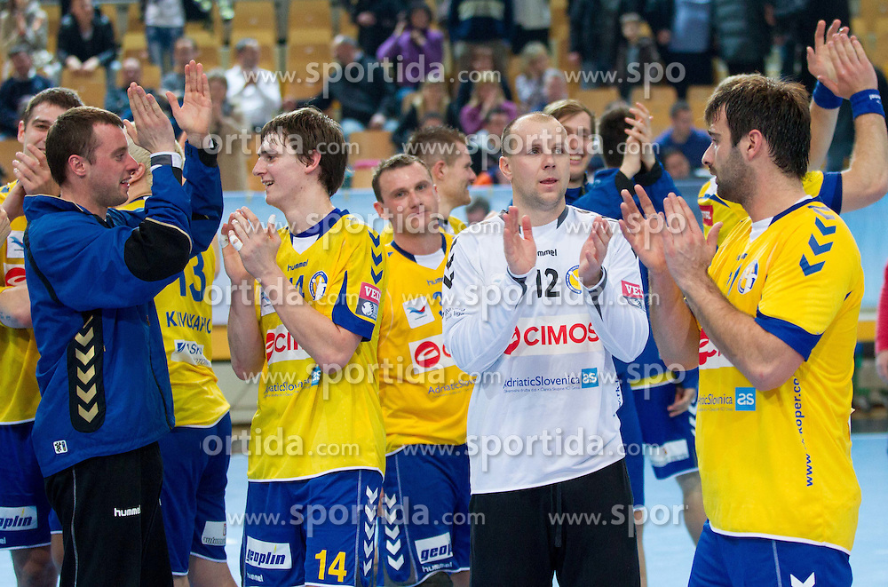 Players of Cimos Koper celebrate after the handball match between RK Cimos Koper and HCM Constanta in 10th Round of season 2011/2012 of EHF Men's Champions League, on February 25, 2012 in Arena Bonifika, Koper, Slovenia. Cimos Koper defeated Constanta 28-24. (Photo By Vid Ponikvar / Sportida.com)