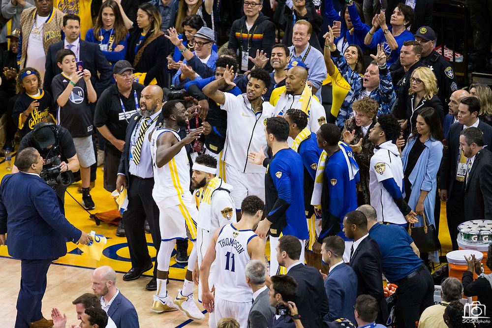 Golden State Warriors forward Draymond Green (23) gets the Golden State Warriors fans excited during a scuffle with the Cleveland Cavaliers during Game 1 of the NBA Finals at Oracle Arena in Oakland, Calif., on May 31, 2018. (Stan Olszewski/Special to S.F. Examiner)