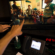 "August 29, 2014 - New York, NY : News Anchor David Muir, whose hand is visible at center, reviews footage from a shoot he did along the Syrian border, in a screening room at ABC on West 66th Street on Friday afternoon. David Muir is taking over for Diane Sawyer as anchor of ABC's ""World News Tonight."" CREDIT: Karsten Moran for The New York Times"