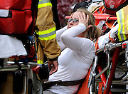 An evacuated passenger reacts as she is attended to by a A New York City Fire Department EMT at 60th Street and Broadway after a Brooklyn bound F train derailment on Friday, May 2, 2014 in Woodside, N.Y.
