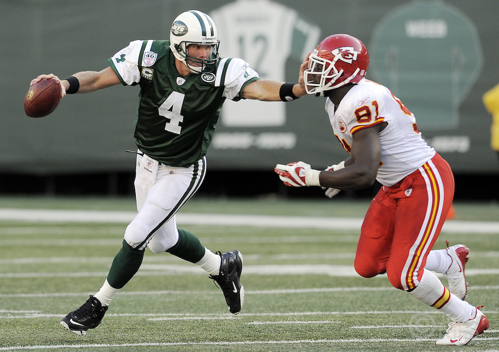 The Jets' Brett Favre (L) tries to push off the Chiefs' Devard Darling (R) during the fourth quarter of the game between the Kansas City Chiefs and the New York Jets at Giants Stadium in East Rutherford, New Jersey on 26 October 2008. The Jets won, 28-24.