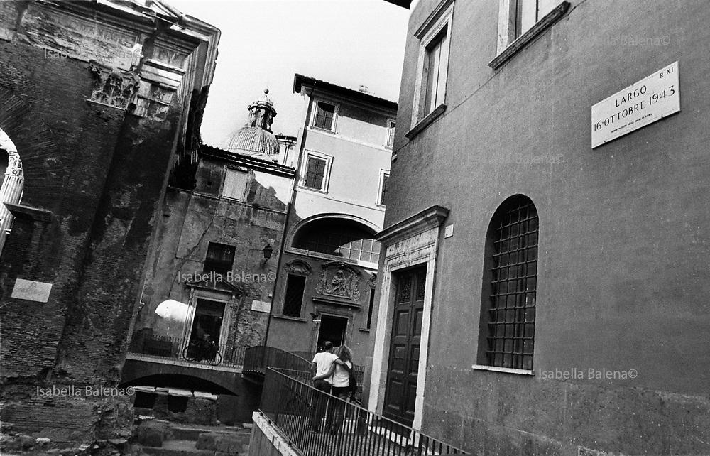 Italia, 2004, dal libro Ci resta il nome. Roma. Il 16 ottobre 1943 inizia il rastrellamento degli ebrei nel ghetto presso il Portico d'Ottavia. Vengono prelevate 1267 persone, di cui deportate 1024, tra cui 207 bambini. Solo 17 tornarono da Auschwitz. Alla fine della guerra si contano 2091 ebrei romani scomparsi. Rome. On 16 October 1943, the round-up of the Jews of the Portico d'Ottavia ghetto began. 1,267 people were rounded up, 1,024 of whom, including 207 children, were deported to Auschwitz. Only 17 returned. By the end of the war, 2,091 Roman Jews had disappeared arte, arts, cultura, culture, monument, monumento, sito storico, heritage site