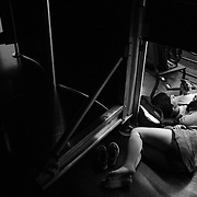 Amelia Malone, of Missouri, 15, and Liam Flaherty, of Pittsburg, 17,  take a nap backstage during practice at Corson Auditorium at interlochen Center for the Arts in Interlochen, Michigan.