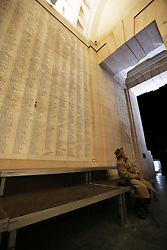 A veteran sits amongst the names inscribed at the Menin Gate in Ypres, Belgium, Sunday, 10th November 2013 , where the Duke of Edinburgh will attend a Last Post ceremony  to mark the gathering of soil from Flanders Fields for a memorial garden at the Guards Museum in London, on Armistice Day tomorrow (Monday 11th November)  Picture by Stephen Lock / i-Images