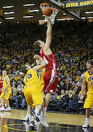 January 19 2013: Wisconsin Badgers forward Zach Bohannon (34) is fouled by Iowa Hawkeyes guard/forward Eric May (25) during the second half of the NCAA basketball game between the Wisconsin Badgers and the Iowa Hawkeyes at Carver-Hawkeye Arena in Iowa City, Iowa on Sautrday January 19 2013. Iowa defeated Wisconsin 70-66.