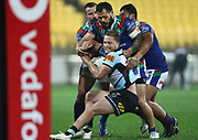 Sharks Matt Moylan is tackled during the NRL rugby league match between the Warriors and Sharks at Westpac Stadium in Wellington on Friday the 19th of July 2019. Copyright Photo: Grant Down / www.Photosport.nz