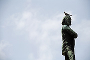 A bird rests on the head of a statue at the Necropolis Cristobal Colon cemetery in Havana, Cuba on Saturday June 28, 2008.